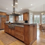 Kitchen in luxury home with wood and granite island